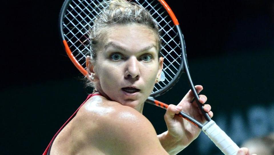 Simona Halep of Romania hits a return against Caroline Garcia of France during the WTA Finals.