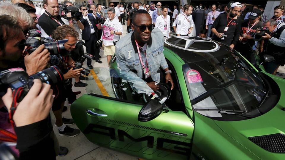 Austin: Sprinter Usain Bolt gets into a car to ride a lap with driver Lewis Hamilton. (AP)