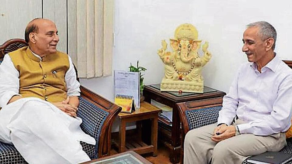 Union home minister Rajnath Singh with former director of the Intelligence Bureau and current Kashmir interlocutor, Dineshwar Sharma, in New Delhi on Monday.