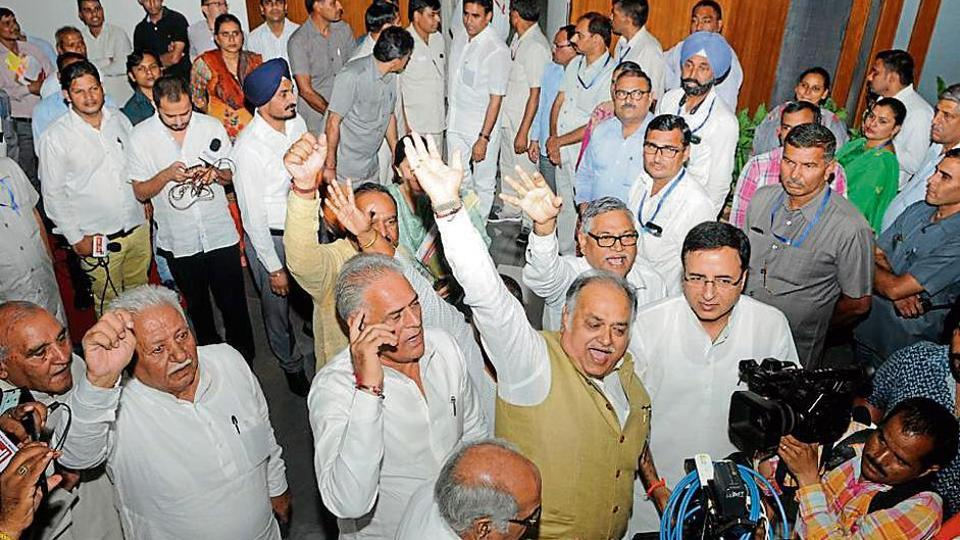 Congress MLAs raising slogans as they walk out of the House after they were expelled from the assembly, in the Haryana Vidhan Sabha on Monday.