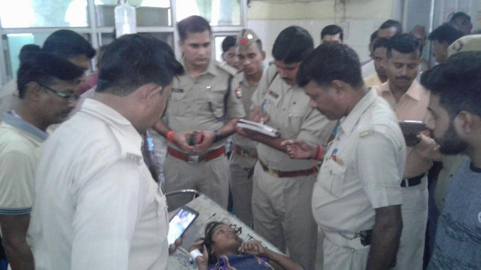 Police officials record the statement of the one of the injured sisters. (HTPhoto)