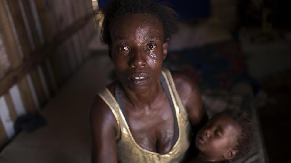 'Every day is a struggle to survive,' 40-year-old Simone Batista said, recounting being cut from 'Bolsa Familia', a government subsidy program for low-income people in Brazil. Tens of millions of Brazilians emerged from poverty between 2004-14 as the country's economy boomed, financing welfare programs that put money into the pockets of the poorest. But that trend has reversed over the last two years due to the deepest recession in Brazil's history and cuts to its subsidy programs. (Silvia Izquierdo / AP)