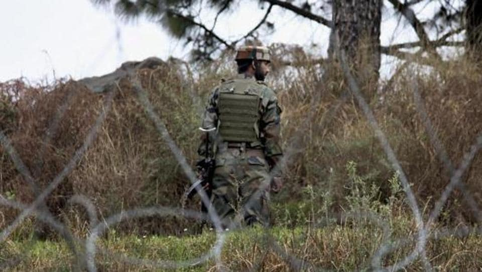 An Indian Army jawan patrolling at the Line of Control (LOC) in Poonch district of Jammu and Kashmir .
