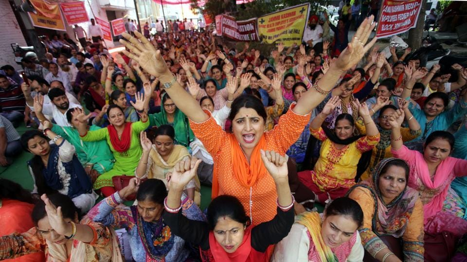 Jammu and Kashmir health employees' association shout slogans during a protest against the state government in Jammu on Tuesday.
