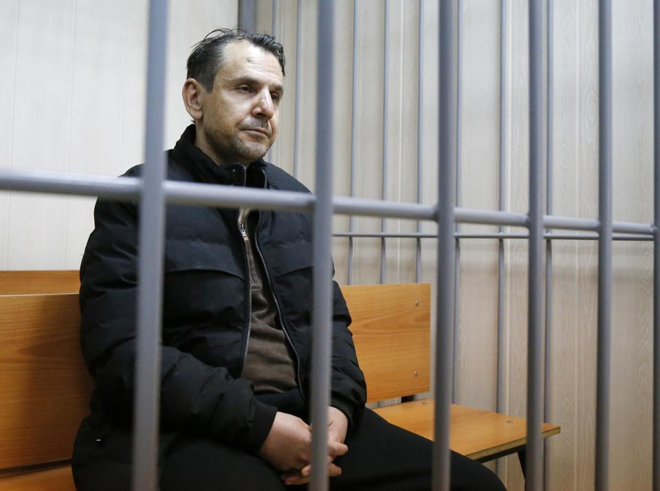 Boris Grits, 48, who holds Russian and Israeli citizenship, sits inside a cage in a court room in Moscow, Russia, Tuesday, October 24, 2017.