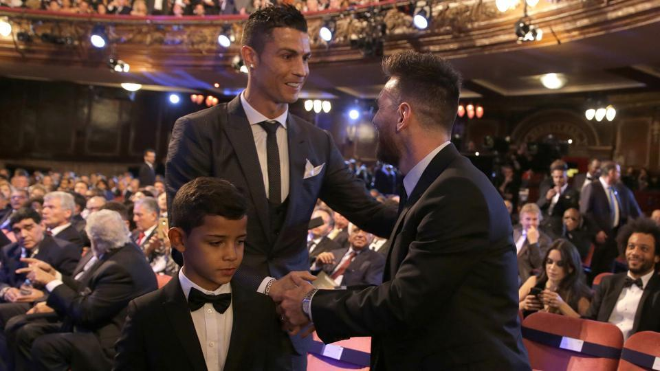 Ronaldo, left, shakes hands with Lionel Messi during the The Best FIFA 2017 Awards at the Palladium Theatre in London, Monday, Oct. 23, 2017.