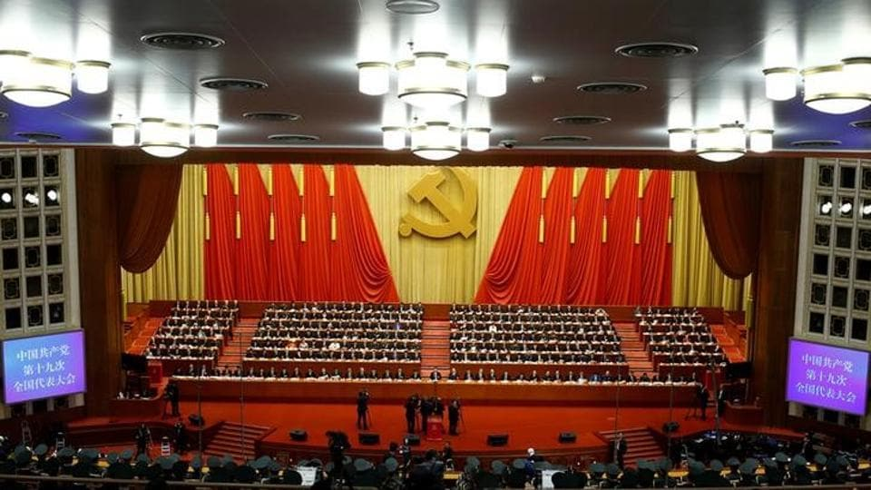 Delegates attend the closing session of the 19th National Congress of the Communist Party of China at the Great Hall of the People in Beijing on October 24, 2017.