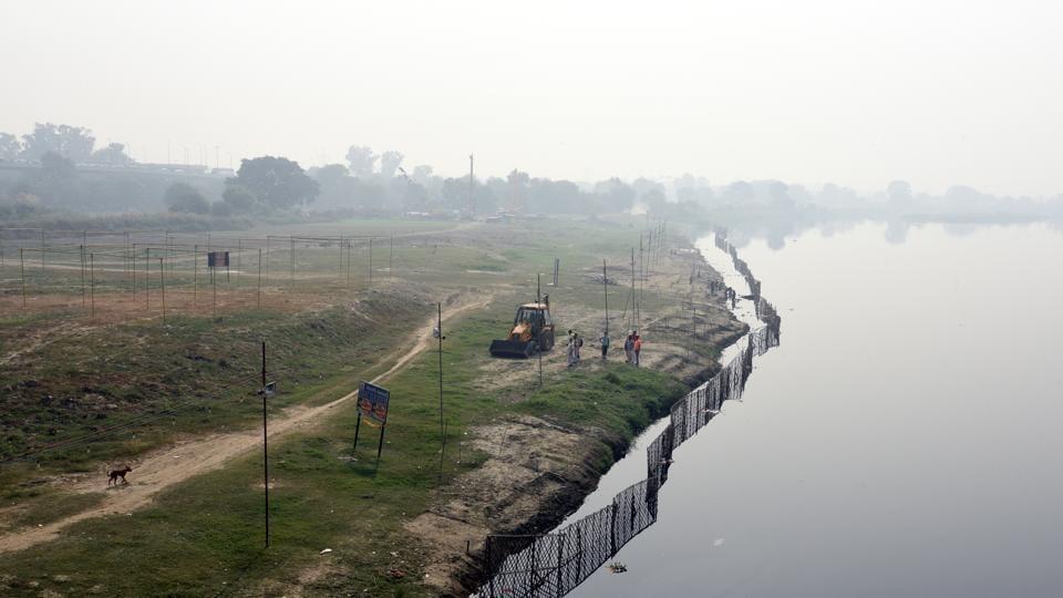 East Delhi Municipal corporation workers clean Yamuna Ghat ahead of Chhat Puja, in New Delhi.