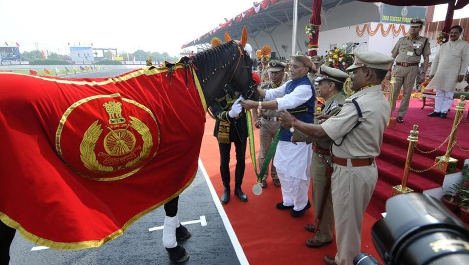 Union home minister Rajnath Singh felicitates Black Beauty, a thoroughbred, during the 56th Raising Day of the Indo Tibetan Border Police force  in Greater Noida on Tuesday.