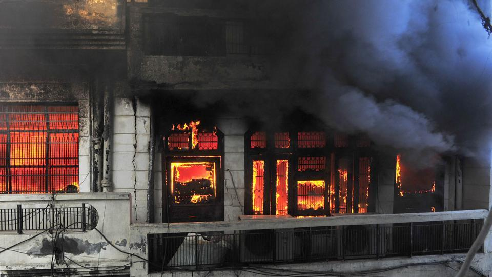 Flames billow out after a a major fire broke out at a garment manufacturing unit in Maharaja Ranjit Singh Park area near Shingaar Cinema in Ludhiana on Tuesday morning.