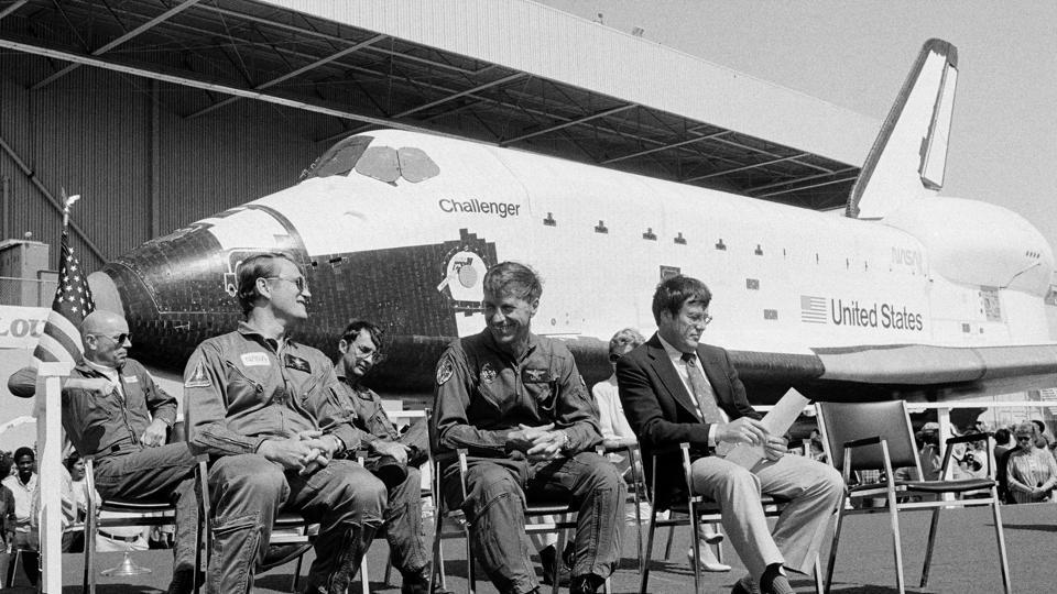 In this June 30, 1982, file photo, the new space shuttle Challenger sits behind the four astronauts that will fly it during turnover ceremonies at Rockwell International's final assembly site in Palmdale, Calif. From left: Dr. Story Musgrave, pilot Karol J. Bobko, mission specialist Donald H. Peterso, and commander Paul J. Weitz. Weitz, a retired NASA astronaut who commanded the first flight of the space shuttle Challenger and flew on Skylab in the early 1970s, has died at 85.