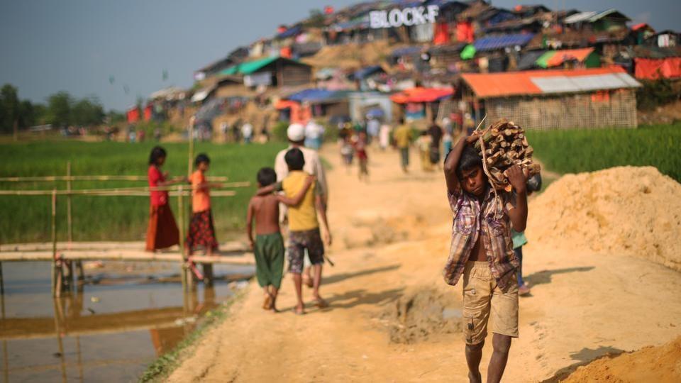 A Rohingya refugee boy carries supplies through Palong Khali refugee camp near Cox's Bazar, Bangladesh, October 24, 2017