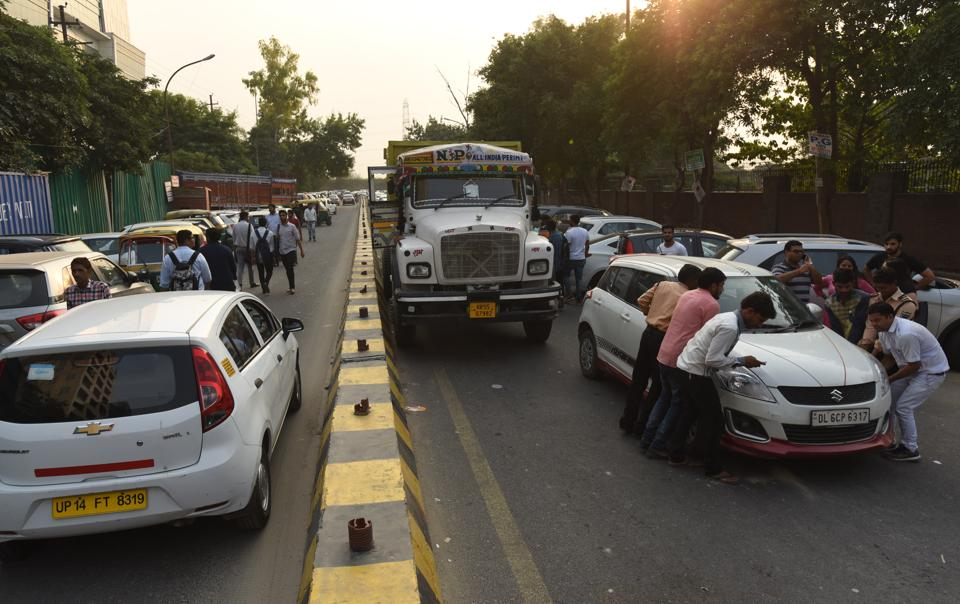 Unauthorized parking along the road outside Amity University in Sector 126 often leaves no space for traffic to move.