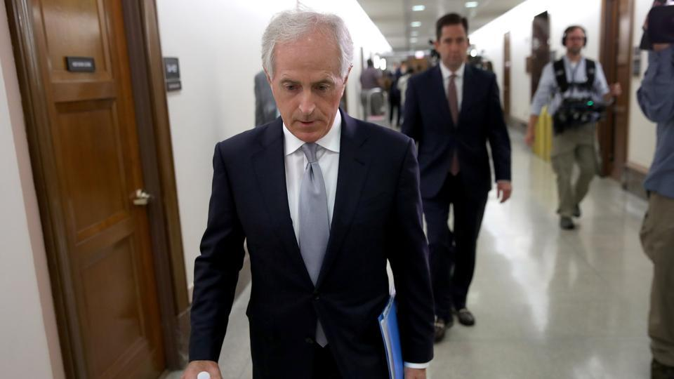 Senator Bob Corker walks to a committee hearing after speaking to members of the press on Capitol Hill about US President Donald Trump on Tuesday.