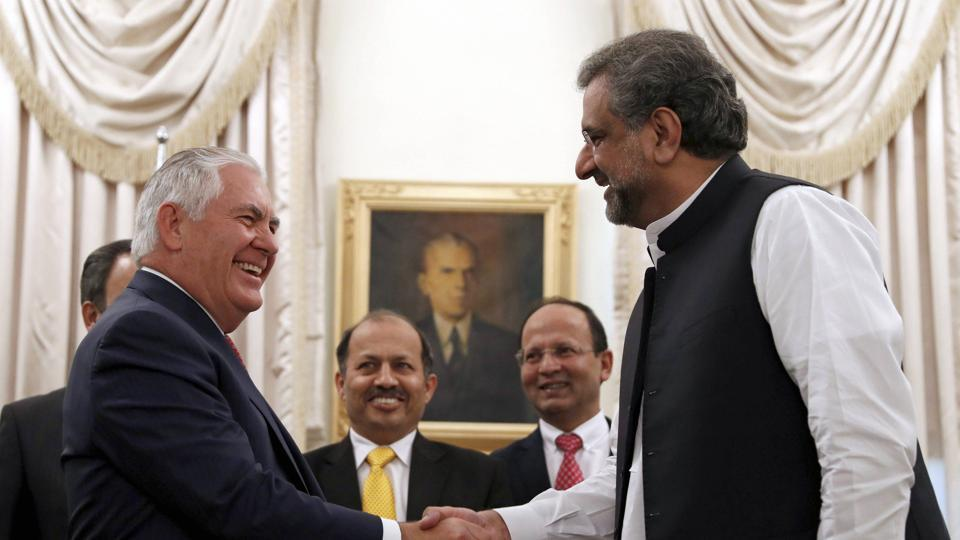 US secretary of state Rex Tillerson shakes hands with Pakistan Prime Minister Shahid Khan Abbasi before their meeting at the Prime Minister's House in Islamabad on October 24, 2017.
