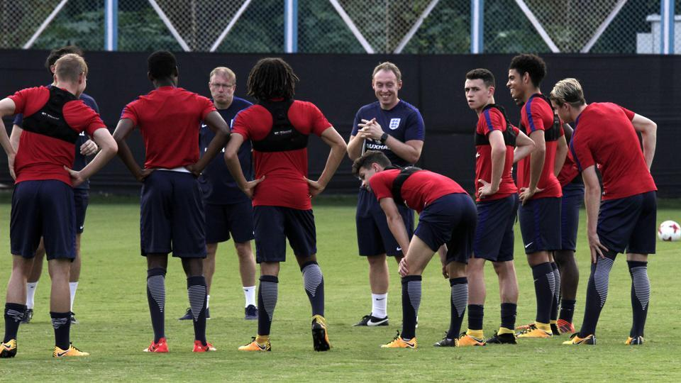 England team coach Steven Cooper, fifth right, interact with players during the training session. (AP)