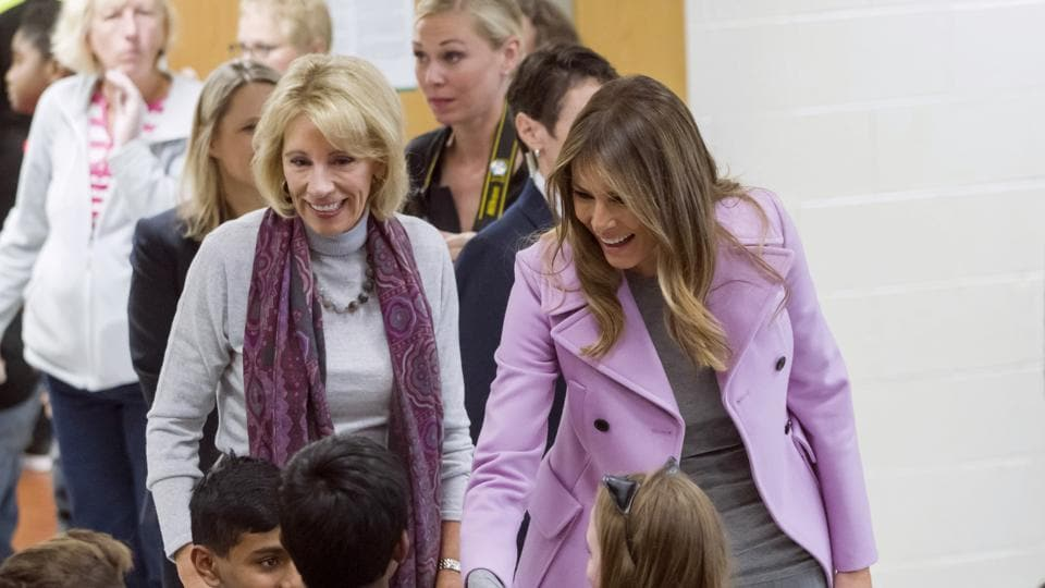 Secretary of education Betsy DeVos, left, and first lady Melania Trump chat with students during a visit to Orchard Lake Middle School in West Bloomfield, Michigan , Monday