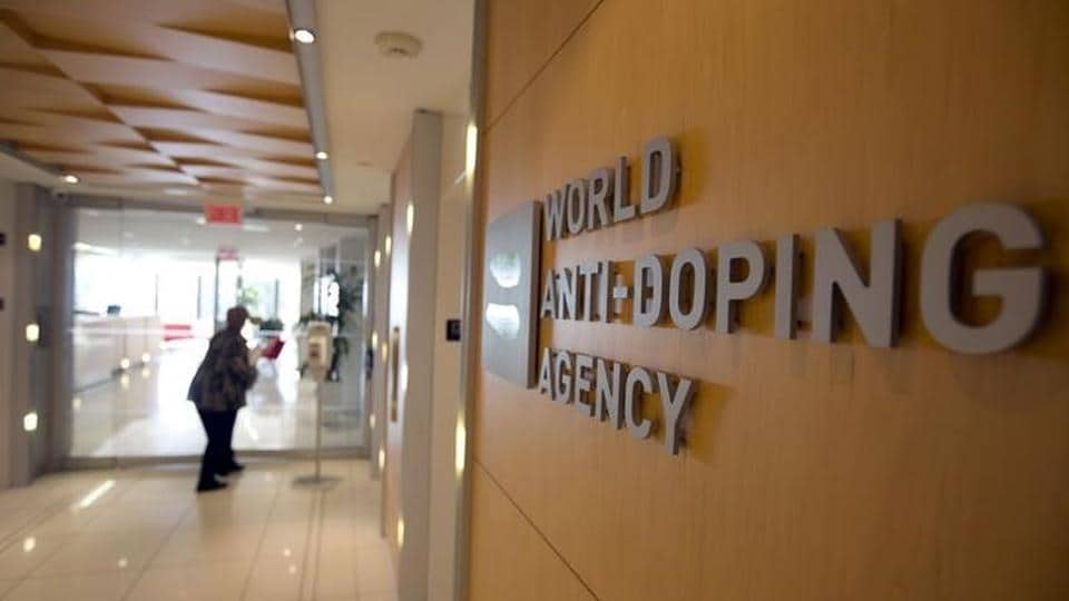 A woman walks into the head office of the World Anti-Doping Agency (WADA) in Montreal, Quebec, Canada.