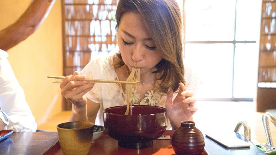 It is a tradition in Japan to noisily slurp down noodles to show appreciation for the food.  But foreign visitors are often bothered by the noise.