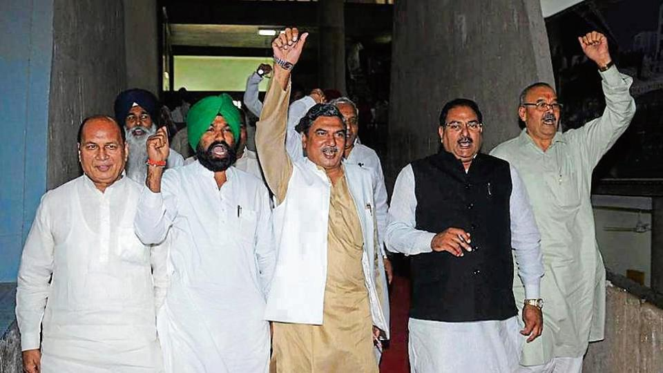 Indian National Lok Dal  leaders protesting outside the Haryana Vidhan Sabha after they walked out of the House on the second day of session in Chandigarh on Tuesday.