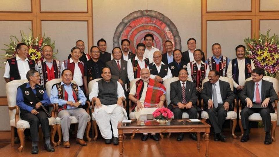 A file picture shows Prime Minister Narendra Modi and Union home minister Rajnath Singh with Naga leaders after signing the framework agreement in 2015. Seated on the extreme right is R N Ravi, chief interlocutor and Prime Minister Narendra Modi's envoy, who is leading the Centre's team of interlocutors.