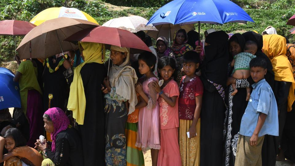 Rohingya Muslim refugees wait for relief aid at Balukhali refugee camp in the Bangladeshi district of Ukhia on October 25, 2017. Myanmar and Bangladesh have agreed to work together to repatriate hundreds of thousands of Rohingya Muslim refugees, officials said.