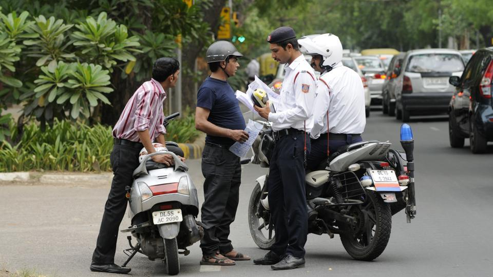 Delhi traffic police issue challans to two-wheeler riders in New Delhi on June 10, 2017.