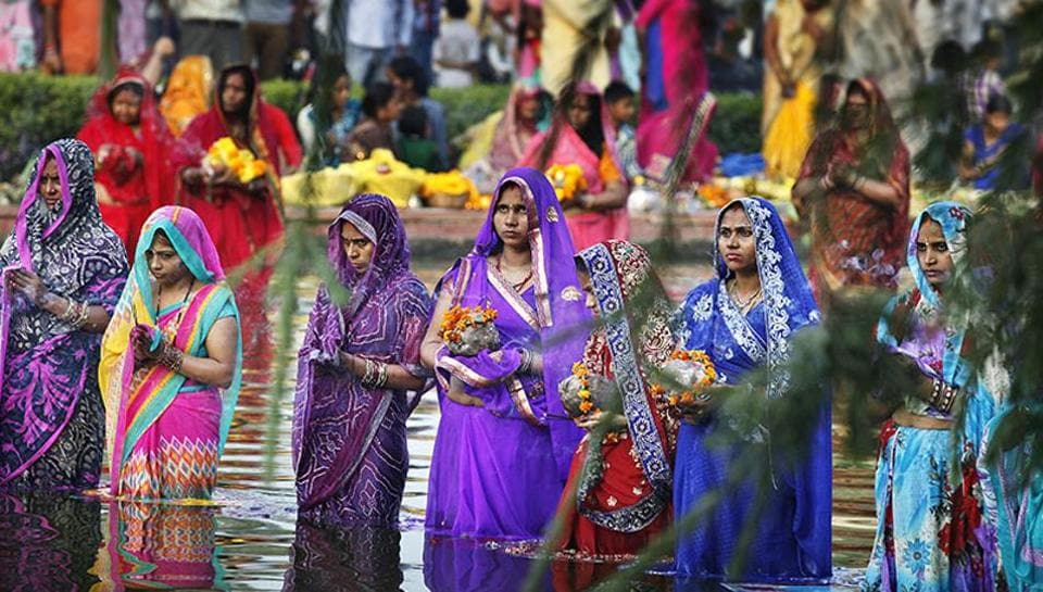 Devotees offer prayers to the sun during Chhath Puja in Delhi.