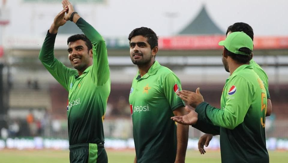 Pakistan cricketers celebrate their victory at the end of the fifth ODI against Sri Lanka.