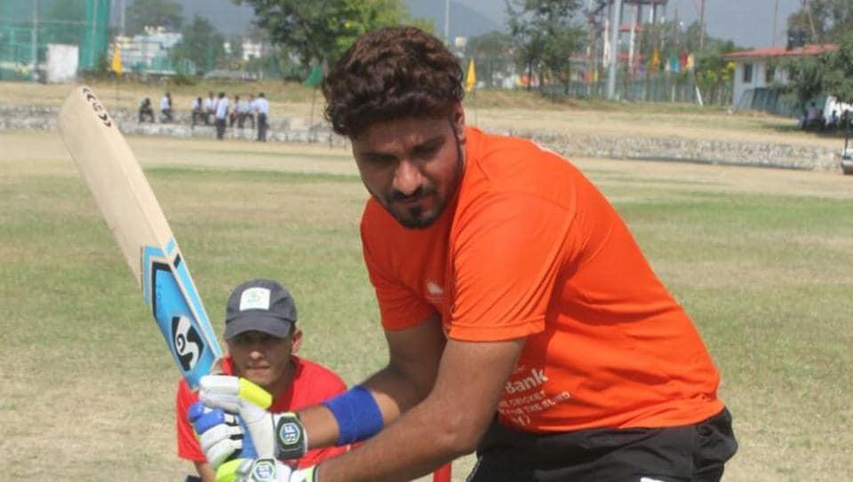 Deepak Malik of Haryana in action during the cricket match against Uttarakhand  on Wednesday. Malik went on to score 364 runs.