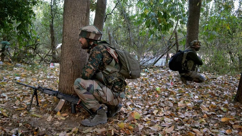 Army personnel take positions during an encounter in which three militants were killed, at Gatipora Keller in Shopian district of south Kashmir on October 9, 2017.