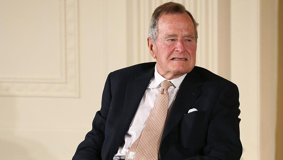 File photo taken on July 14, 2013 shows former US president George HW Bush as he sits in a wheelchair during an event in the East Room at the White House in Washington. Bush has issued an apology to an actress who accused him of groping her from his wheelchair while attending a screening, according to reports. Heather Lind, 34, said the incident occurred four years ago at an event to promote the TV series Turn: Washington's Spies.