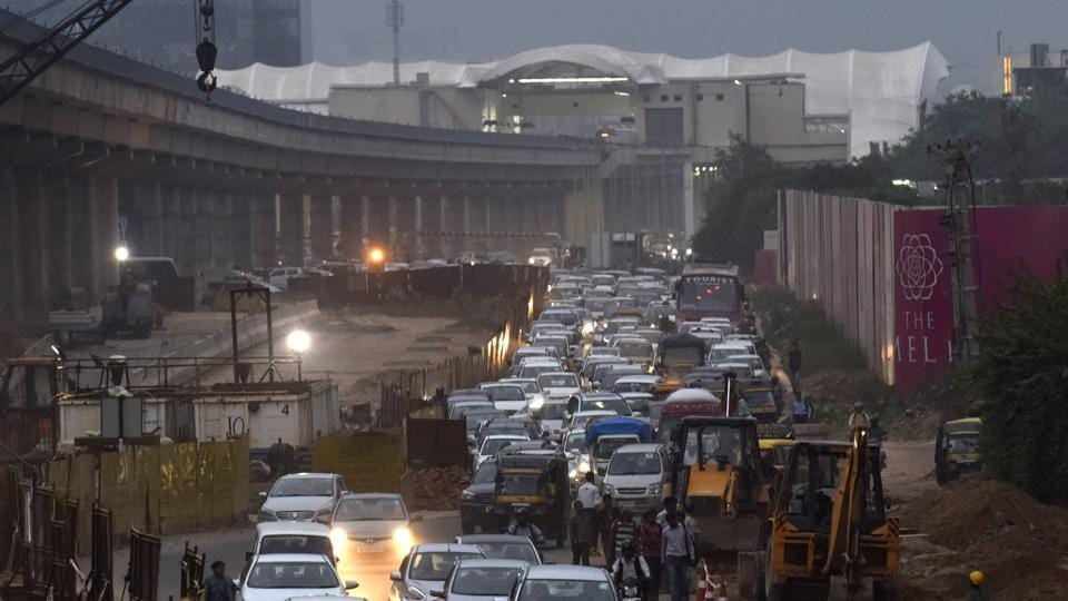 Heavy traffic on Golf Course Road near Genpact crossing due to the road widening work.