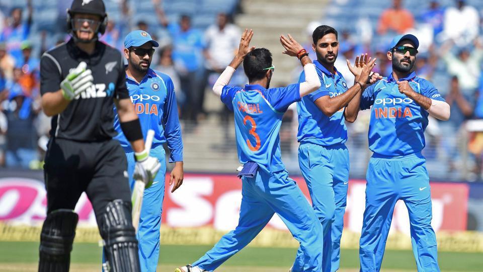 Bhuvneshwar Kumar celebrates the dismissal of Martin Guptill during the India vs New Zealand second ODIin Pune.