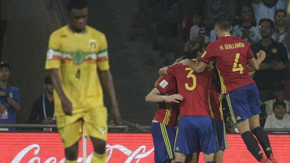 Spain's players celebrate after scoring a goal against Mali during their semi-final FIFA U-17 World Cup match in Mumbai. Spain won 3-1 and will play England in the final.