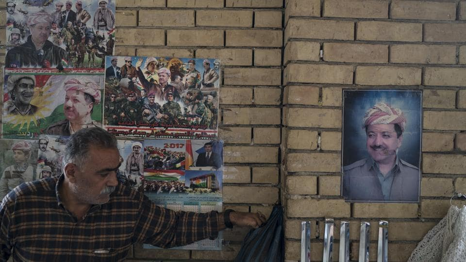 Photos of Kurdish president Masoud Barzani hang on the walls of the central bazaar in Arbil, Iraq, Wednesday. In Sept. 2017, Iraq's Kurds celebrated their symbolic vote for independence, but instead of moving forward with negotiations toward a smooth divorce from Baghdad, they have lost their most important oil-producing city to Iraqi troops.