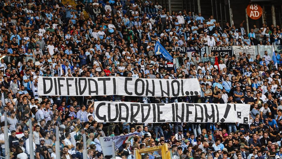 In this Oct. 1, 2017 file photo, Lazio fans display a banner reading in Italian