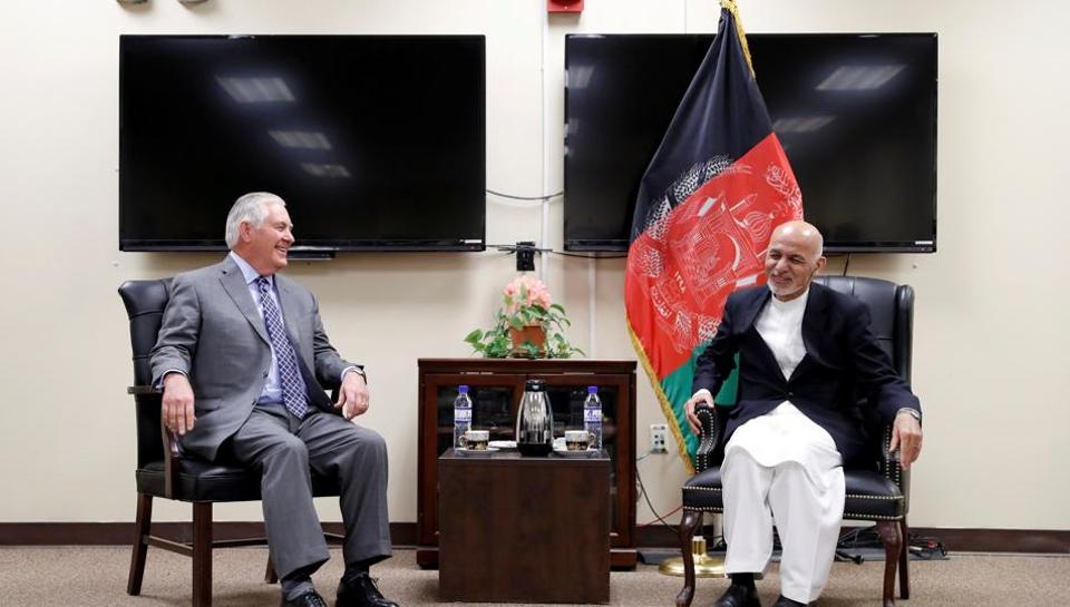 US secretary of state Rex Tillerson speaks with Afghan President Ashraf Ghani during their meeting at Bagram Air Field, Afghanistan October 23, 2017.