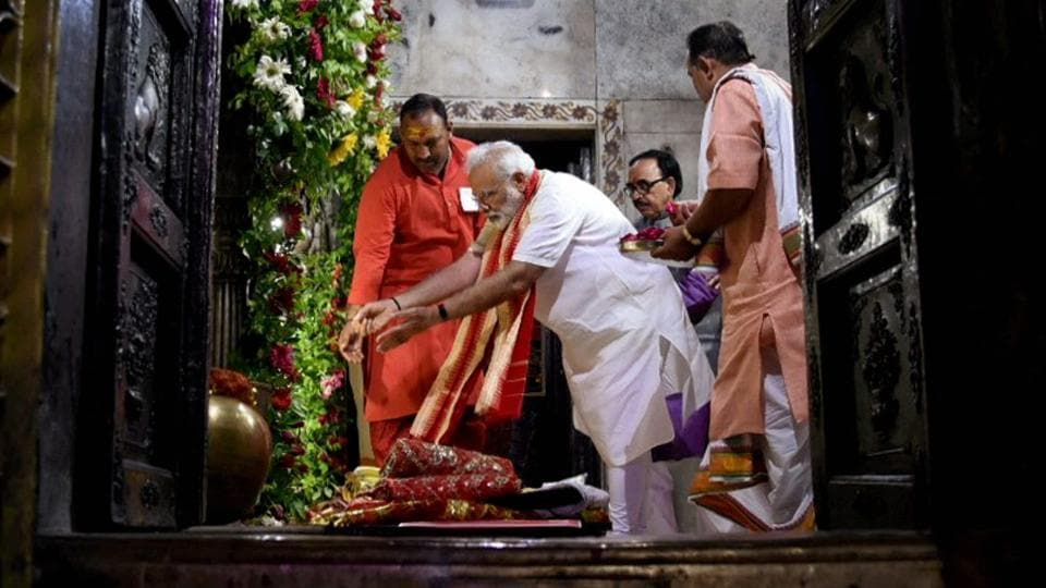 Prime Minister Narendra Modi offers prayers at Durga Mata Temple in Varanasi. Modi will offer prayers at the Lord Manjunatha temple at Dharmasthala in Karnataka on October 29.