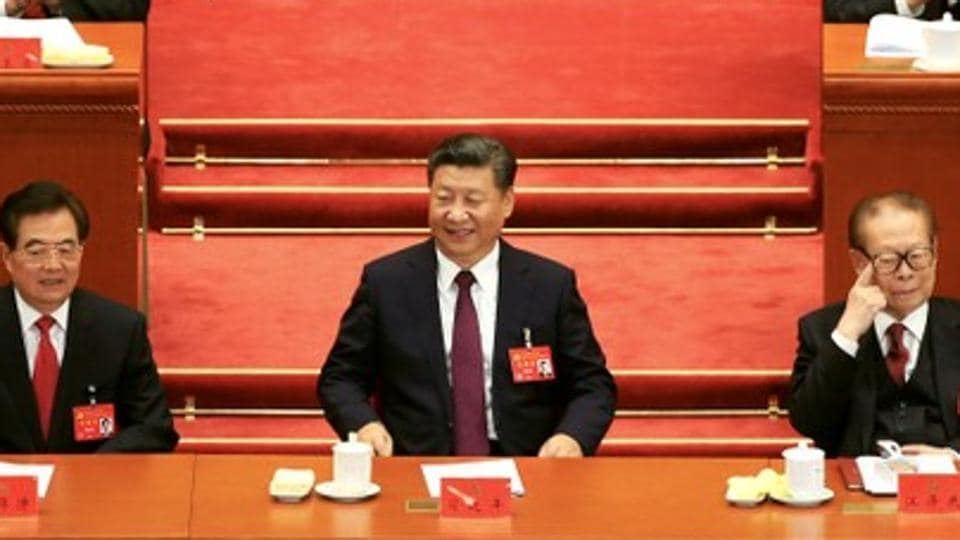 L-R: Former Chinese President Hu Jintao, Chinese President Xi Jinping, former President Jiang Zemin, are seen during the opening session of the 19th National Congress of the Communist Party of China at the Great Hall of the People, in Beijing.