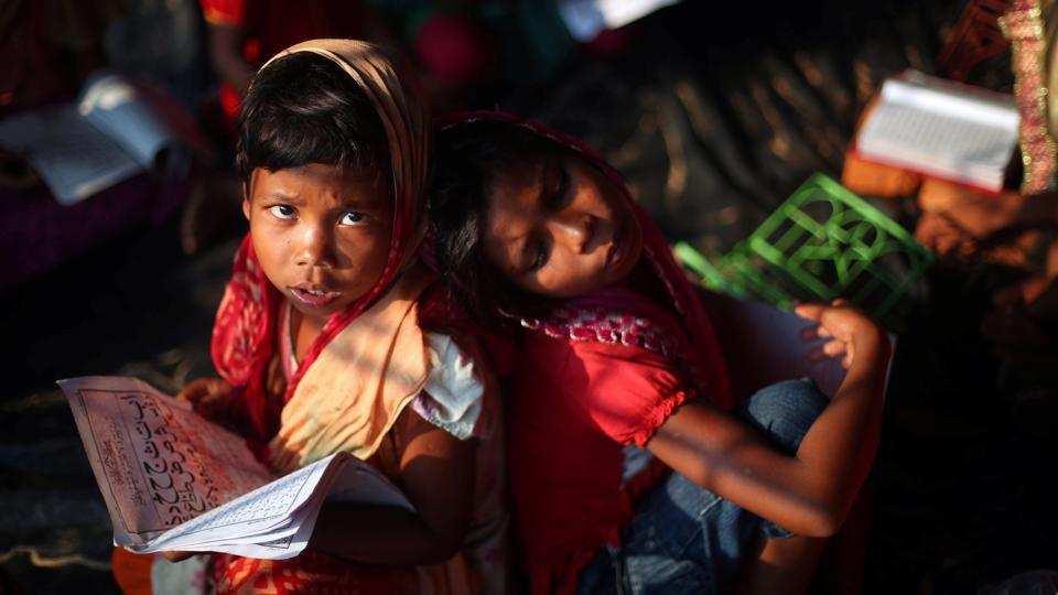 A refugee girl reads the Quran during a lesson at a mosque in Palong Khali refugee camp near Cox's Bazar on October 24, 2017. (Hannah McKay / REUTERS)