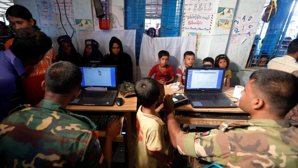 Rohingya refugees are registered by Bangladeshi army personnel at a registration center in Kutupalong refugee camp in Cox's Bazar on October 20, 2017. (Zohra Bensemra / REUTERS)