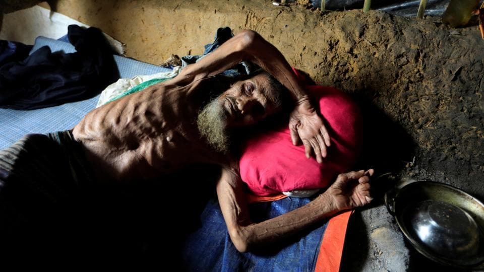 An elderly Rohingya refugee man lies at his shelter in Kutupalong refugee camp in Cox's Bazar on October 20, 2017. (Zohra Bensemra / REUTERS)
