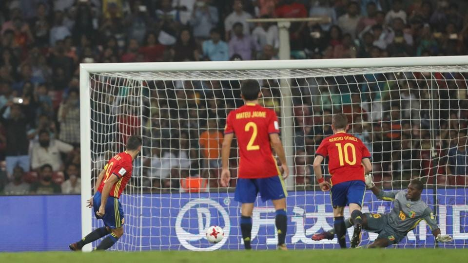 Spain's Abel Ruiz scores a penalty to give Spain the lead.  (REUTERS)