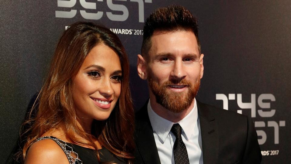 Barcelona's Lionel Messi poses with his wife Antonella Roccuzzo before the start of the FIFABest Players awards in London on Monday. A doctored image of Messi has been used by terror group ISIS to threaten the 2018 FIFA World Cup in Russia.