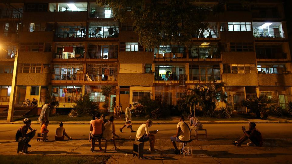 A crowd is engrossed in their mobile devices at a hotspot in Havana, Cuba. The introduction of Wi-Fi hotspots in Cuban public spaces two years ago has transformed the Communist-run island that had been mostly offline. Nearly half the population of 11 million connected at least once last year. This exposure has whet Cubans' appetite for better and cheaper access to the internet. (Alexandre Meneghini / REUTERS)