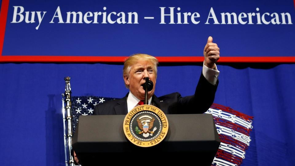 US President Donald Trump speaks before signing an executive order directing federal agencies to recommend changes to a temporary visa program used to bring foreign workers to the United States.