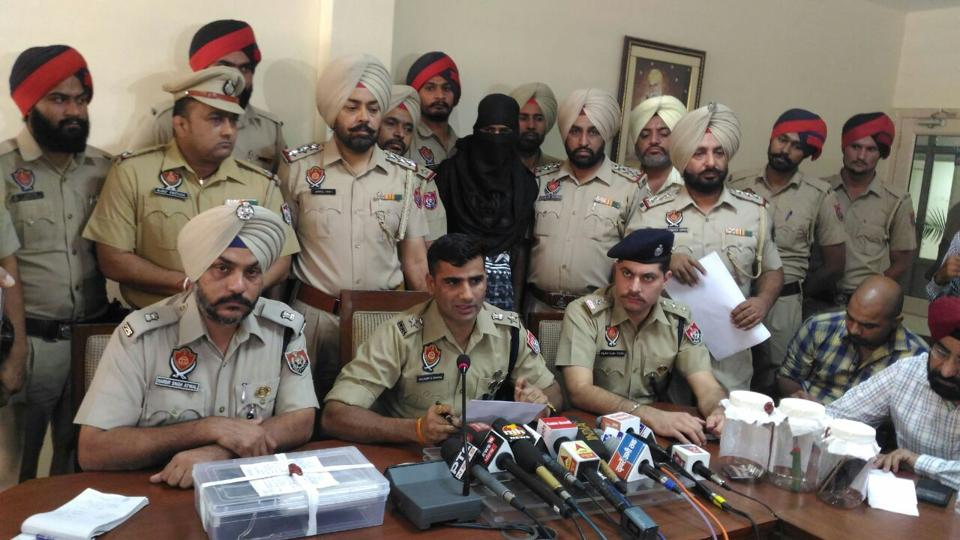SSP Mohali Kuldeep Chahal (centre) addressing a press conference at the SSP office in Mohali on October 26. The accused from UP was intercepted in the car after a chase on Sohana road on Wednesday night. Police sources said he confessed to being involved in the murder.   (Anil Dayal/ht)