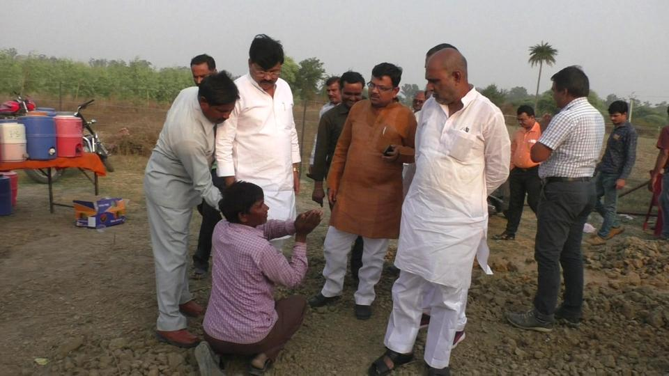 Farmer Devendra Kumar Dohrey pleads with UP jail minister Jai Kumar Singh Jaiki in Orai of Jalaun district on Thursday after the latter's cavalcade ran over his field, allegedly destroying the seeds sown a week back.