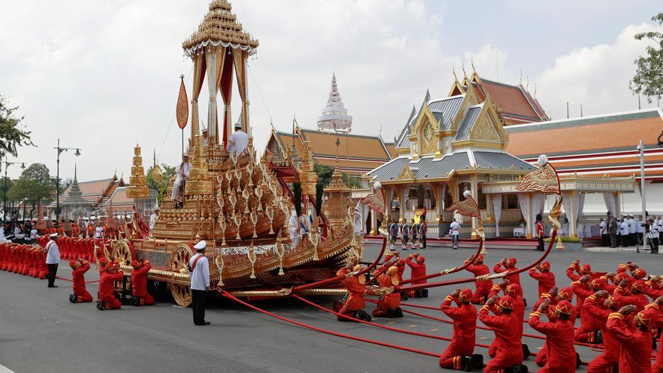 The Royal Urn of King Bhumibol Adulyadej is placed on the Great Victory Chariot during the cremation procession at the Grand Palace in Bangkok. By tradition, deceased royals have been kept upright in elaborate urns but Bhumibol, opted to be put in a coffin, with the urn placed next to it for devotional purposes. The royal chariot is pulled by soldiers using red rope and is one of few items in use for royal funerals since 1796. (Damir Sagolj / REUTERS)